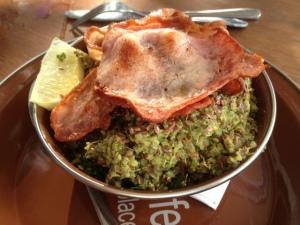 Quinoa scrambled eggs with kale, pesto & bacon
